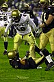 US Navy 031206-N-9693M-031 Navy linebacker Jeremy Chase stands over Army quarterback Zac Dahman after a sack during the 104th playing of the Army Navy game.jpg