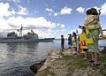 US Navy 040311-N-7833F-010 Family and friends of Sailors aboard the guided missile cruiser USS Port Royal (CG 73), wave as it passes Hospital Point, Pearl Harbor, Hawaii.jpg