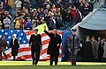 US Navy 041204-N-2383B-197 President Bush is escorted to mid field for coin toss during 105th Army Navy game.jpg