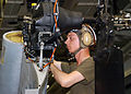 US Navy 050112-N-4451V-029 Lance Cpl. Damian Root installs a tail rotor drive shaft into an AH-1W Super Cobra helicopter in the hanger bay aboard the amphibious assault ship USS Bonhomme Richard (LHD 6).jpg