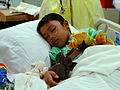 US Navy 050214-N-0357S-060 An 11-year old Indonesian boy rests in a hospital bed in the Intensive Care Unit aboard the Military Sealift Command (MSC) hospital ship USNS Mercy (T-AH 19).jpg