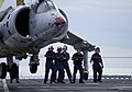 US Navy 050217-N-9866B-001 Aviation Boatswain's Mates work together to provide guidance to a AV-8A Harrier training aircraft as the aircraft is hoisted in the air during a flight deck training drill aboard the amphibious assaul.jpg