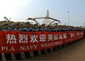 US Navy 050328-N-7526R-053 Members of China's People's Liberation Army (PLA) hold a banner welcoming the Sailors and Marines aboard USS Blue Ridge (LCC-19) to Zhanjiang, People's Republic of China.jpg