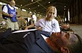 US Navy 050526-F-6655M-074 Stacey Asbury, a registered nurse for the Florida Disaster Medical Assistance Teams, assesses wounds on a simulated patient during exercise Lifesaver 2005.jpg