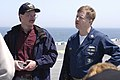 US Navy 060420-N-9900B-162 IBM Distinguished Engineer John Dinger speaks with amphibious assault ship USS Wasp's (LHD 1) Command Master Chief Mark Butler about flight operations.jpg