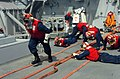 US Navy 060421-N-5307M-599 Sailors react to a crash and salvage drill aboard the guided-missile destroyer USS Stout (DDG 55).jpg