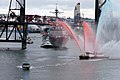 US Navy 060608-N-7783B-001 A Portland fire boat greets the Arleigh Burke-class guided missile destroyer USS Preble (DDG 88) with red white and blue water streams as she passes under the Willamette river's Steel Bridge.jpg