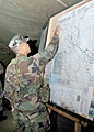 US Navy 060831-N-3560G-010 Lt.jg Neil Ebuen of Naval Mobile Construction Battalion Four (NMCB-4) reviews the Operations and Intel Tracker.jpg