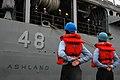 US Navy 061116-N-2456S-189 Line handlers of the Harper's Ferry-class dock landing ship USS Oak Hill (LSD 51) prepare the Whidbey Island-class dock landing ship USS Ashland (LSD 48) for deployment.jpg