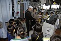 US Navy 071019-N-2812S-064 Fire Controlman 1st Class George Day gives Shiori Elementary School students a tour of the guided-missile cruiser USS Cowpens' (CG 63) pilothouse.jpg