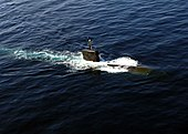 US Navy 071111-N-7090S-016 The Los Angeles-class nuclear-powered fast-attack submarine USS Miami (SSN 755) surfaces in the North Arabian Sea during an anti-submarine warfare (ASW) exercise with the Enterprise Carrier Strike Gro