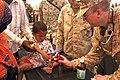 US Navy 071202-N-5642P-021 A Hospital Corpsman of the 22nd Marine Expeditionary Unit (Special Operations Capable) gives a stuffed animal to a patient after being medically treated.jpg