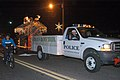 US Navy 071206-N-2070C-001 Members of the Naval Air Station Whiting Field Security Department pull the base's float during the Milton Christmas Parade.jpg