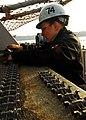 US Navy 080116-N-6538W-005 Fire Controlman 3rd Class Geneva Myers performs maintenance on the PHALANX close-in weapons system (CIWS) on the fantail aboard USS John C. Stennis (CVN 74).jpg