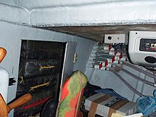 US Navy 080913-N-0000F-027 In this photo released by the U.S. Coast Guard, packages of cocaine are stored in a compartment of a self-propelled, semi-submersible vessel interdicted at sea.jpg