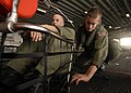 US Navy 080915-N-6439C-004 Aviation Warfare Systems Operator 3rd Class Andrew Byer and Aviation Warfare Systems Operator Airman Chris Carpenter perform operational checks on search and rescue gear.jpg