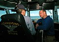 US Navy 081013-N-6984M-013 Capt. J.R. Haley, commanding officer of the Nimitz-class aircraft carrier USS George Washington (CVN 73), speaks to the Sailor of the day, Personnel Specialist Seaman Takuya Tsuboi, about flight opera.jpg
