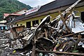 US Navy 091001-F-3798Y-217 A storefront is blocked Oct. 1, 2009 by debris along the main road of Pago Pago after a tsunami struck American Samoa Sept. 29, 2009.jpg