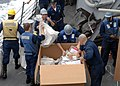 US Navy 100209-N-7088A-110 Sailors stationed aboard the Arleigh Burke-class guided-missile destroyer USS Farragut (DDG 99) unpack a pallet of mail during an underway replenishment.jpg
