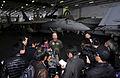 US Navy 101209-N-7103C-161 Capt. Ross Myers speaks with embarked Japanese reporters in the hangar bay aboard USS George Washington (CVN 73).jpg