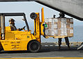 US Navy 110322-N-8607R-311 Marines load humanitarian assistance supplies onto a CH-53E Sea Stallion helicopter aboard the forward-deployed amphibio.jpg