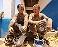 US Navy 110331-N-SN160-035 Steelworker 3rd Class Caleb Baker and Equipment Operator Constructionman Eric Hofmans take a hydration break during the.jpg