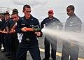US Navy 110524-N-BK435-123 Sailors and civilian mariners assigned to the submarine tender USS Frank Cable (AS 40) practice hose handling procedures.jpg