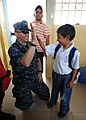 US Navy 110524-N-NY820-312 Cmdr. Mark Stewart gets a high-five during a Give A Kid A Backpack community service event at a school in Manta, Ecuador.jpg