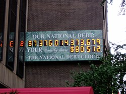 Photo of the National Debt Clock on September 24, 2004, at which time it read approximately 7.3 trillion USD in national debt