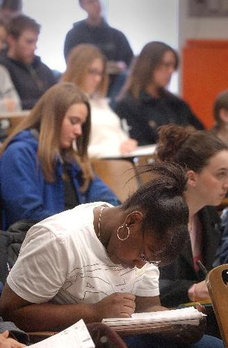 Veterinary education - Students at the School of Veterinary Medicine at the University of Wisconsin–Madison take notes during a June 2005 classroom lecture.