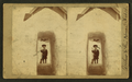 View of a child with a shovel standing behind a tunnel of snow in front of a house, from Robert N. Dennis collection of stereoscopic views.png