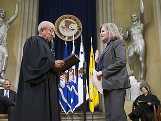 Virginia A. Seitz - Judge Harry Edwards swears in Seitz as Assistant Attorney General in 2011