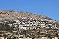 Vista de les urbanitzacions i del cim del Puig Llorença.JPG