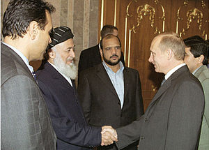 Mohammed Fahim - Marshal Fahim (center) standing next to former Afghan President Burhanuddin Rabbani and former Russian President Vladimir Putin in October 2001.