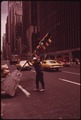 WORKER MOVES TRAFFIC LIGHT AT SIXTH AVENUE AND 47TH STREET - NARA - 554308.tif