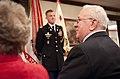 Walter Krzycki, right, attends a promotion ceremony for his son, U.S. Army Lt. Col. David Krzycki, at the Pentagon's Patriot Room in Arlington, Va., April 3, 2013 130403-A-AJ780-007.jpg