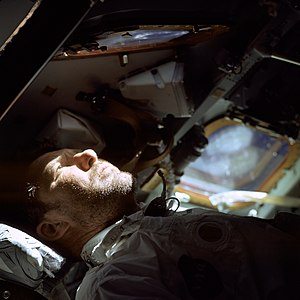 Apollo 7 - Walter Schirra looks out the rendezvous window in front of the commander's station on the ninth day of the mission
