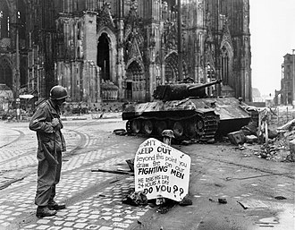 Cologne Cathedral - US soldier and destroyed Panther tank, 4 April 1945.