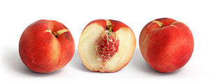 White peach and its cross section isolated on ...