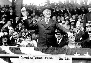 President Woodrow Wilson throws out the ceremonial first pitch on opening day. Photo 1916