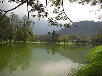 Mining in Malaysia - Former mine which has been converted into a lake garden in Perak.