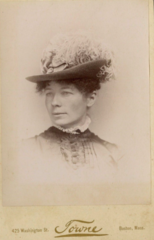 Woman in hat by Towne of 425 Washington Street in Boston.png