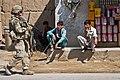 Woman warrior on patrol near Bagram Air Field 120606-A-ZU930-010.jpg