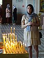 Woman with Candles in Church - Grodno - Belarus (27699932251) (4).jpg