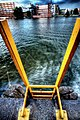 Yellow ladder into bluegreen water (220289010).jpg
