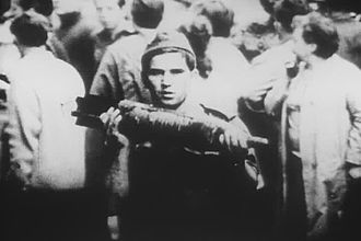 Warsaw Pact invasion of Czechoslovakia - Soviet soldier with a tank shell – possibly having brought it out of a burning tank.