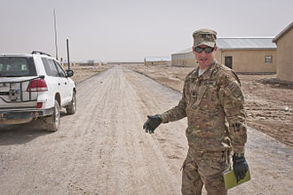 Paktika Province - Forward Operating Base Super FOB commander explaining the paving process for one of the streets of Camp Super FOB, which will be the largest training and operations base for the Afghan National Army when completed.