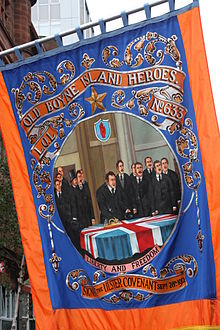 An orange banner showing the signing of the ulster covenant