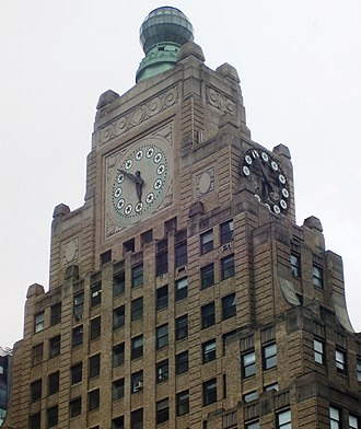 1501 Broadway - The top of the building, featuring the clock and globe, as seen from the west