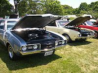 1968 (left) and 1969 (right) Oldsmobile 442s. Post-war American muscle cars with V8 engines.